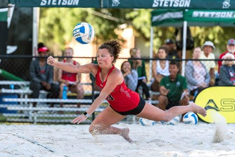 Austin Peay Beach Volleyball freshman Lucy Randall digs for the ball during Thursday's ASUN Tournament match against Coastal Carolina. (Romeo T. Guzman, ASUN)