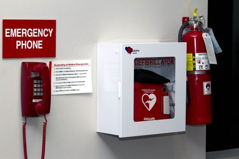 Wall mounted AED with emergency phone. (American Heart Association)