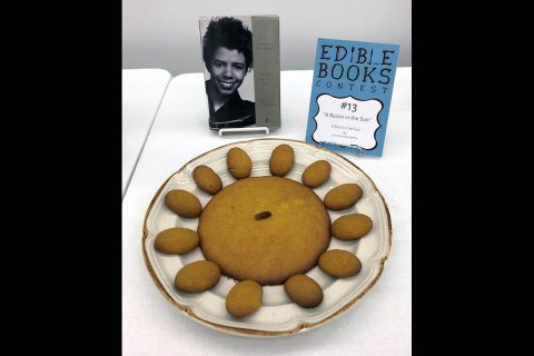 "Several cookies and a single raisin represent Lorraine Hansberry's play, ""A Raisin in the Sun."""