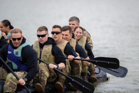 Austin Peay State University ROTC cadet Kylie Head smiles as she and her teammates propel a Zodiac boat at Liberty Park in Clarksville. (Benny Little, APSU)