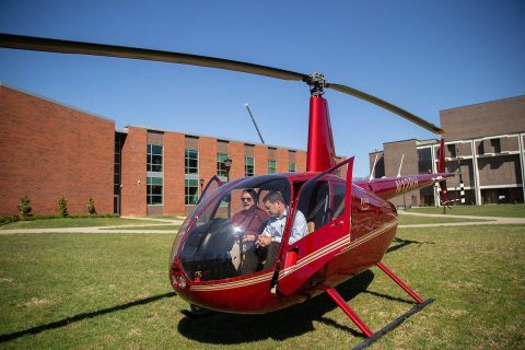 Austin Peay State University aviation science program director and chief pilot Charlie Weigandt shows GOV 3 to U.S. Rep. Mark Green. GOV 3 is one of three in APSU's helicopter fleet. (APSU)