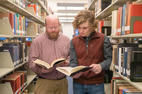 Austin Peay State University professor Dr. Kevin Harris and student Nick Foreman review expert literature at the library. (APSU)