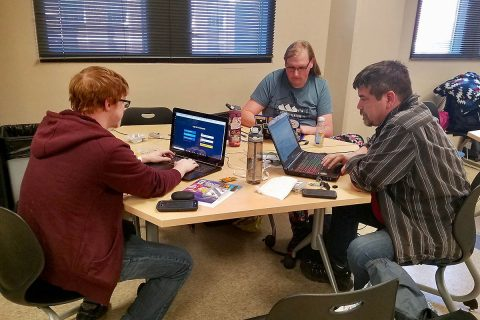 From the left, Austin Peay State University students Aidan Murphy, Susan Kersten and Nathan Nickelson work on their hacks.
