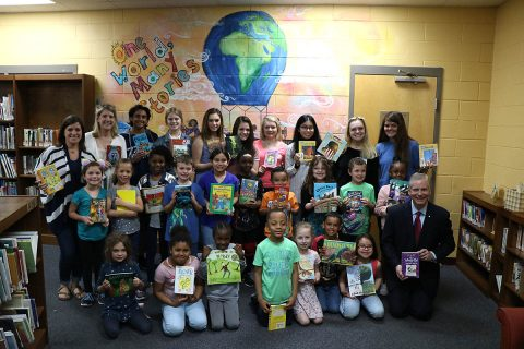 The Norman Smith Elementary School book club and staff members show off their donated books with members of the Clarksville Mayor's Youth Council and Mayor Joe Pitts. The council ran a book drive last September, collecting 1,012 books in total, to donate to several elementary schools in the community. Norman Smith Elementary received more than 700 donated books.