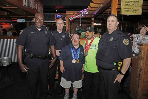 Clarksville Police took part in Texas Roadhouse's Tip A Cop event to raise money for Special Olympics, Monday.