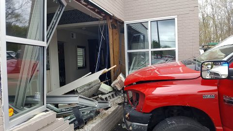 A pickup truck loses control on Madison Street and then crashes into the Edge Salon. (Jim Knoll/Officer Holder, Clarksville Police)