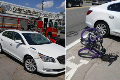 A car turned in front of a bicyclist this morning on Riverside Drive.