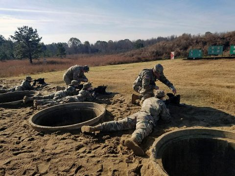 Cadre from Middle Tennessee State University's Reserve Officer Training Corps program assist cadets with making adjustments on their M4 rifles during the group and zero portion of the M4 qualification range assisted by the 716th Military Police Battalion. (Sgt. 1st Class Carlos Davis, 101st Airborne Division (AA) Sustainment Brigade Public Affairs)