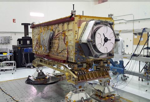 "OCO-3 sits on the large vibration table (known as the ""shaker"") in the Environmental Test Lab at the Jet Propulsion Laboratory. (NASA/JPL-Caltech)"