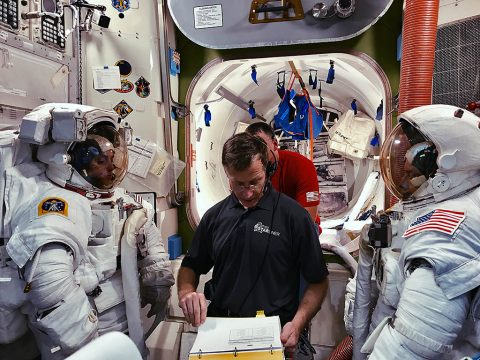 Chris Ferguson, with Boeing, helps Nicole Mann, left, and Mike Fincke, right, both with NASA, train for a spacewalk. (Boeing)