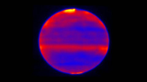 Scientists used red, blue and yellow to infuse this infrared image of Jupiter's atmosphere (red and yellow indicate the hotter regions), which was recorded by the Cooled Mid-Infrared Camera and Spectrograph (COMICS) at the Subaru Telescope on the summit of Mauna Kea, Hawaii on Jan. 12, 2017. (NAOJ and NASA/JPL-Caltech)