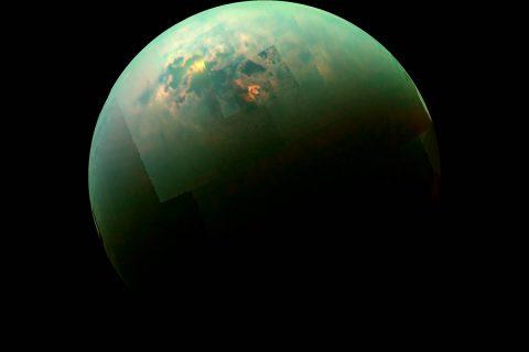 This near-infrared, color view from Cassini shows the sun glinting off of Titan's north polar seas. (NASA/JPL-Caltech/Univ. Arizona/Univ. Idaho)