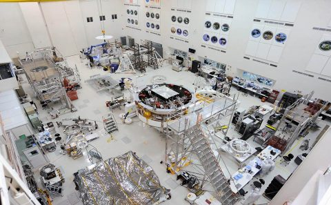 In the center of this image is the Mars 2020 spacecraft stack attached to the Spacecraft Assembly Rotation Fixture (SCARF) in the High Bay 1 clean room in JPL's Spacecraft Assembly Facility. (NASA/JPL-Caltech)