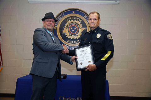 Sergeant Terry Minton is congratulated by Clarksville Police Chief Al Ansley during his retirement ceremony. (Jim Knoll, CPD)