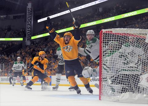Nashville Predators center Rocco Grimaldi (23) celebrates after the game winning goal by Nashville Predators right wing Craig Smith (not pictured) past Dallas Stars goaltender Ben Bishop (30) in overtime of game two of the first round of the 2019 Stanley Cup Playoffs at Bridgestone Arena. (Christopher Hanewinckel-USA TODAY Sports)