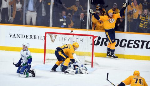 Apr 4, 2019; Nashville, TN, USA; Nashville Predators center Ryan Johansen (92) and Nashville Predators right wing Viktor Arvidsson (33) celebrate after scoring the game-winning goal past Vancouver Canucks goaltender Jacob Markstrom (25) as Vancouver Canucks defenseman Troy Stecher (51) reacts during the third period at Bridgestone Arena. Mandatory Credit: Christopher Hanewinckel-USA TODAY Sports