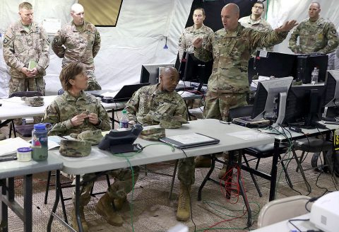 Lieutenant Colonel Paul Bonano (center right), deputy commanding officer for the 101st Sustainment Brigade, 101st Airborne Division (Air Assault), briefs Col. Stephanie Barton, commander of the 101st Sus. Bde., as well as CSM Anthony McAdoo, senior enlisted officer for the brigade, on how set-up and operations during the Tactical Operations Center Exercise have been going, May 13, 2019, on Fort Campbell, Ky. (Staff Sgt. Caitlyn Byrne, 101st Sustainment Brigade Public Affairs)