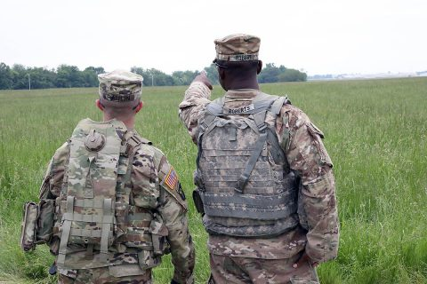 Capt. Andrew Paulin (left), company commander of the Headquarters and Headquarters Company, 'Angry Dogs', 101st Special Troops Battalion, 101st Sustainment Brigade, 101st Airborne Division (Air Assault), and 1st Sgt. Antodd Richards (right), first sergeant of HHC, discuss the location of where to set up the Tactical Operations Center Exercise for the upcoming week's training exercise, May 6, 2019, on Fort Campbell, Ky. (Staff Sgt. Caitlyn Byrne, 101st Sustainment Brigade Public Affairs)