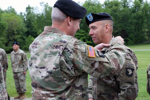 Maj. Gen. Brian Winksi, commanding general, 101st Airborne Division (Air Assault), pins Air Assault wings on Command Sgt. Maj. Bryan Barker, senior enlisted advisor for 101st Airborne Division May 10 at Fort Campbell, Kentucky. (Sgt. First Class Carlos Davis, 101st Airborne Division)
