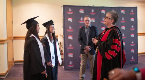 Austin Peay State University President Alisa White talks to Lidia Yanes Garcia, left, and Claudia Yanes Garcia prior to their commencement. (APSU)