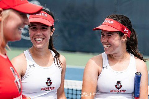Lidia Yanes Garcia, left, and Claudia Yanes Garcia talk during the OVC championship. (APSU)