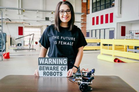 Recent Austin Peay State University computer science graduate Jordan Miller displays her robot in the Technology Building on campus. (APSU)