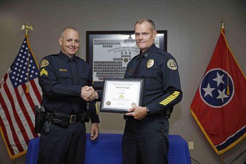 Clarksville Police Chief Al Ansley congratulates Joseph Scruggs on his promotion. (Jim Knoll, CPD)