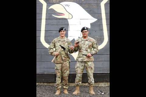 """Pvt. Tony Cateriano (Left) from 1st Battalion, 26th Infantry Regiment and Pvt. Christan Morales (Right) from 1-502nd Infantry Regiment """"First Strike"""", 2nd Brigade Combat Team, Fort Campbell KY, hold up their awards. Cateriano was the Honor Graduate for class 17-19 and Morales was the Ruck March Champion for class 17-19, April 4th, 2019. (Sgt. Justin Navin, 2nd Brigade Combat Team, 101st Airborne Division (AA) Public Affairs)"""