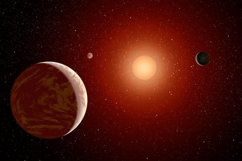 Artist rendering of a red dwarf or M star, with three exoplanets orbiting. About 75 percent of all stars in the sky are the cooler, smaller red dwarfs. (NASA/JPL-Caltech)