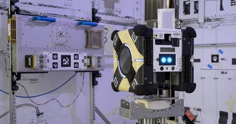 Astrobee flight units and docking unit in granite table lab at the Atomated Science Research Facility N-269 NASA Ames Research Center, Moffett Field in Silicon Valley California. (NASA)