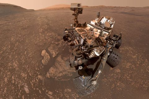 """NASA's Curiosity Mars rover took this selfie on May 12, 2019 (the 2,405th Martian day, or sol, of the mission). To the lower-left of the rover are its two recent drill holes, at targets called """"Aberlady"""" and """"Kilmarie."""" (NASA/JPL-Caltech/MSSS)"""