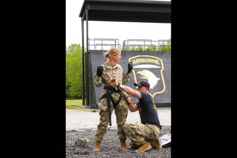 Capt. Lisa Kasper, an Emergency Room Nurse assigned to 3rd Brigade Combat Team, 101st Airborne Division (Air Assault), is inspected by Sgt. Kyle York, an instructor at the Sabalauski Air Assault School at Fort Campbell, KY, May 1st. (U.S. Army photo by Maj. John J. Moore)