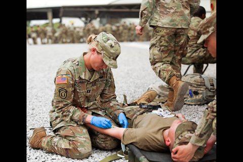 Capt. Lisa Kasper, an Emergency Room Nurse assigned to 3rd Brigade Combat Team, 101st Airborne Division (Air Assault), inserts an intravenous needle into a patient during a training exercise at Fort Campbell, KY, May 1st. (U.S. Army photo by Maj. John J. Moore)