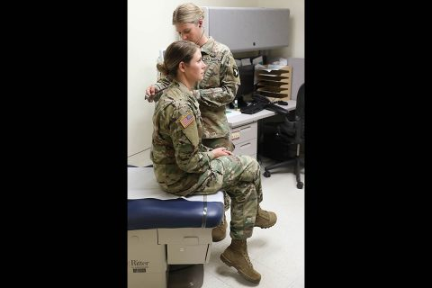 Capt. Lisa Kasper, an Emergency Room Nurse assigned to 3rd Brigade Combat Team, 101st Airborne Division (Air Assault), checks a patient's vitals at Fort Campbell, KY, May 2nd. (U.S. Army photo by Maj. John J. Moore)