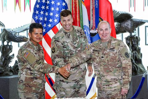 Col. Clair Gill (center), 101st Airborne Division (Air Assault) Deputy Commander, Support, is joined by Fort Campbell's oldest Soldier, Lt. Col. John McDonough (right), assigned to Blanchfield Army Community Hospital, and youngest Soldier, Pvt. Justin Davila (left), of 2nd Battalion, 44th Air Defense Artillery Regiment for a cake cutting ceremony marking the 244th Army Birthday. (Pfc. John Simpson, 101st Airborne Division)