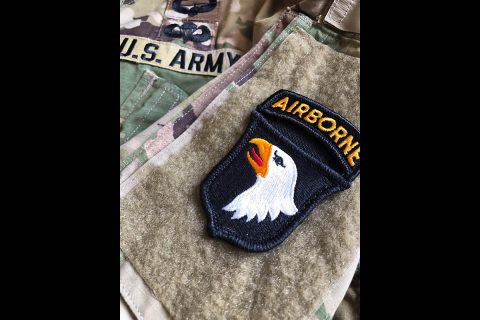 """85 Soldiers assigned to the 101st Airborne Division (Air Assault) are wearing historical colored """"Old Abe patches this week, June 1-9 in Normandy France, to commemorate the 75th Anniversary of the WWII Allied invasion of Normandy, commonly known as D-Day."""