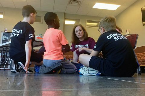 Bridget Cloud teaches the young coders how to program their robots at Austin Peay State University. (APSU)