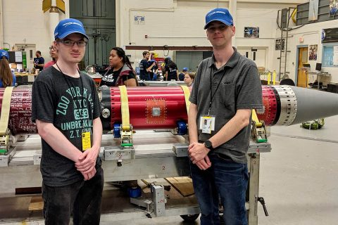 Austin Peay State University students Zach Hill (L) and Zach Givens (R) pose with the rocket that will carry their experiment to space. (APSU)
