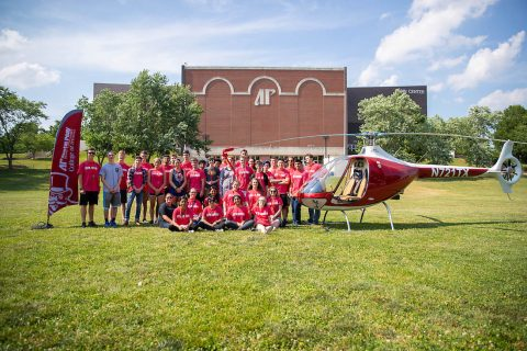 The Governor's School for Computational Physics students stand near one of Austin Peay State University's helicopters. (APSU)