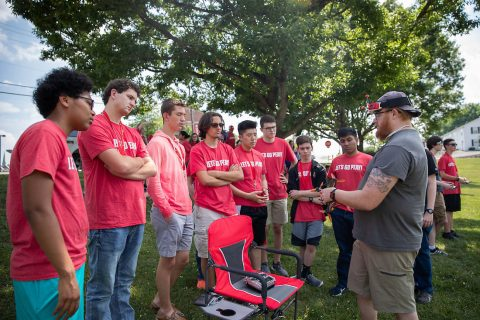 Michael Hunter of the Drone Club at Austin Peay State University shows off one of his racing drones to the Governor's School for Computational Physics students. (APSU)
