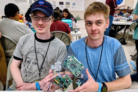 Austin Peay State University students Zach Hill, left, and Zach Givens show off some of their work during Rocket Week at NASA's Wallops Flight Facility in Virginia. (APSU)