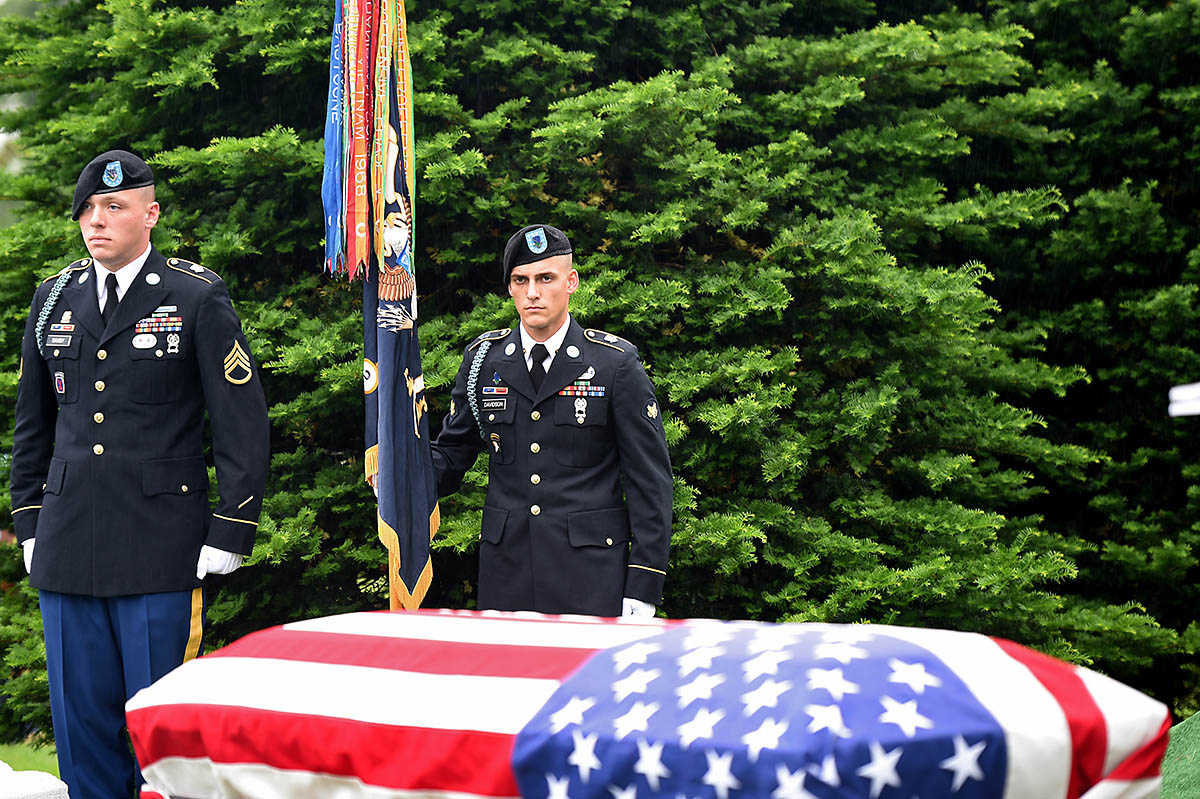 Soldiers assigned to the 101st Airborne Division stand over a casket during the graveside service of Staff Sgt. Al Mampre at Memorial Park Cemetery in Skokie on Saturday, June 15, 2019. Mampre served as a medic with Easy Company, 2nd Battalion, 506th Parachute Infantry Regiment, 101st Airborne Division during World War II. (Sgt. David Lietz)