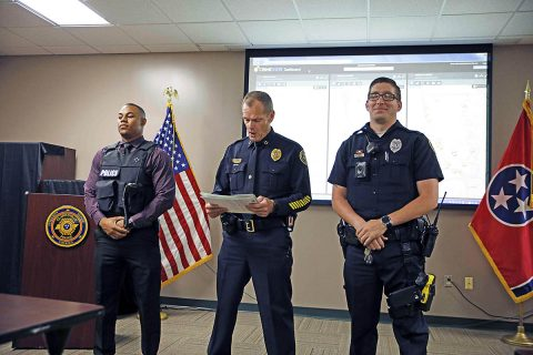 Clarksville Police Officer Shavell Lucas (L) and Officer Brandan Hendricks (R) receiving Lifesaver Awards from Police Chief Al Ansley (C).