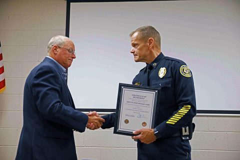 Clarksville Police Chief Al Ansley (R) shakes Deputy Chief Mike Parr (L) hand at his retirement ceremony.