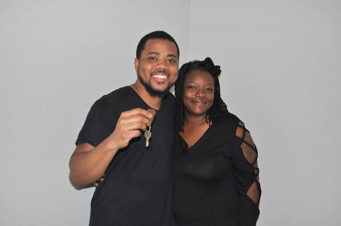 Mario Owens and Overlia Williams with the key to their new home.