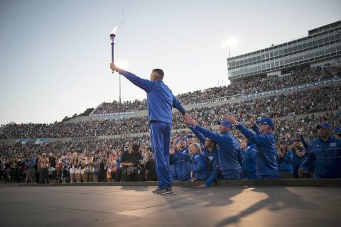 Shay Hampton, Department of Defense Warrior Games athlete raises the ceremonial torch at the opening ceremony of the Games in Colorado Springs, Colorado, June 2, 2018. This year's opening ceremony is June 22 in Tampa, Florida. Four Soldiers from the Fort Campbell Warrior Transition Battalion are among the 300 U.S and international competitors.  (U.S. Air Force, Senior Airman Dennis Hoffman)