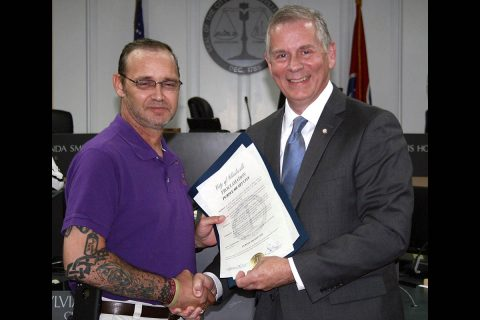 Clarksville Mayor Joe Pitts congratulates Mark Stuart for his work to have Clarksville designated as a Purple Heart City.