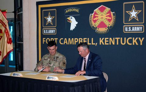 (L) Fort Campbell Garrison Commander Colonel Joseph Kuchan and (R) Montgomery County Mayor Jim Durrent sign the Intergovernmental Support Agreement between Montgomery County Animal Care & Control and Fort Campbell.
