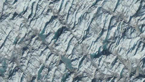 The Greenland Ice Sheet is the second-largest body of ice in the world, covering roughly 650,000 square miles of Greenland's surface. If it melts completely, it could contribute up to 23 feet of sea level rise, according to a new study using data from NASA's Operation IceBridge. (NASA / Jefferson Beck)