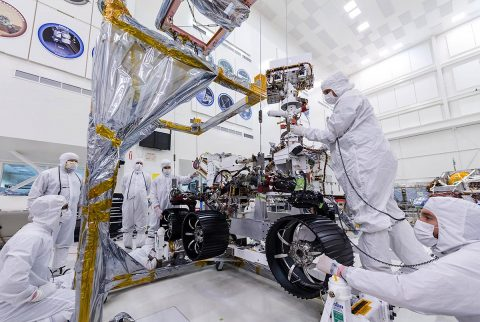 In this image, taken on June 13th, 2019, engineers at JPL install the starboard legs and wheels - otherwise known as the mobility suspension - on the Mars 2020 rover. (NASA/JPL-Caltech)